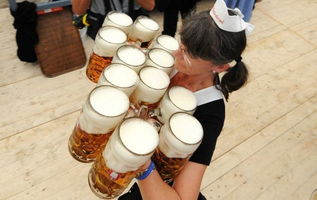 "A waitress carries beer during the Oktoberfest beer festival on September 19, 2009 at the ""Theresienwiese"" in Munich, southern Germany. The world famous Oktoberfest takes place from September 19 to October 4, 2009 and is with over six million visitors the world's largest folk festival. AFP PHOTO /  JOE KLAMAR (Photo credit should read JOE KLAMAR/AFP/Getty Images)"