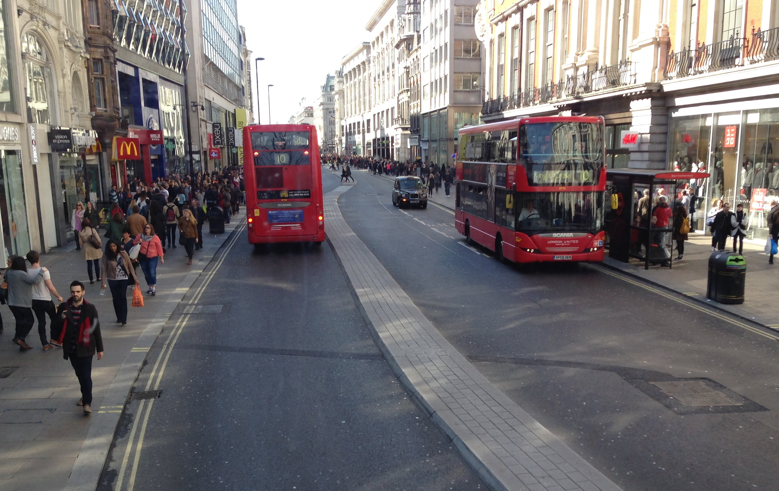 Buses and people on Oxford Street London - 1